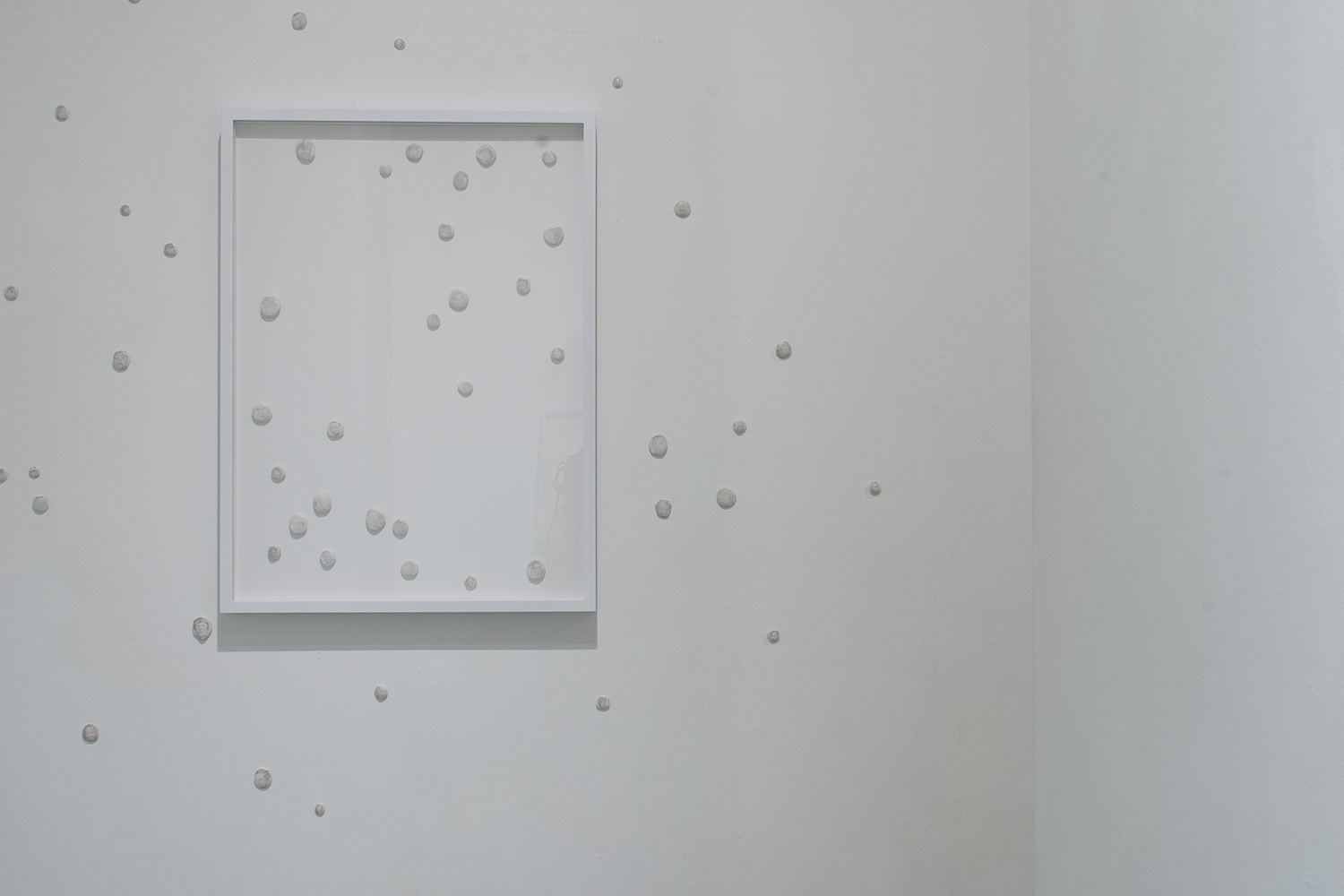 cosmos ︱ frame,  white tac, ink transferred from news print ︱dimensions variable